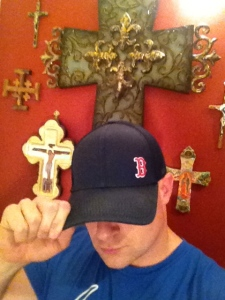 The man himself in front of his crucifix collection from around the world.